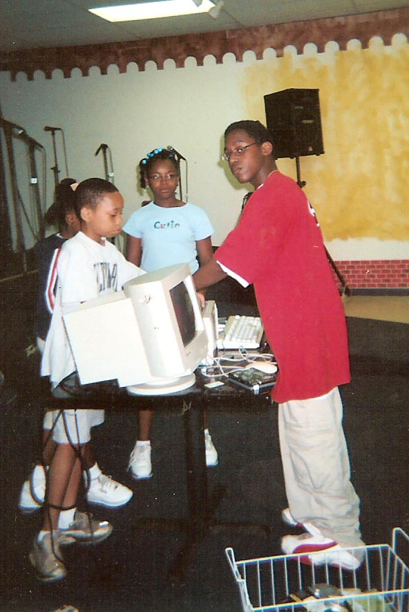 2004-Mentor William teaching class on Commputer Repair for Summer Program ROTB